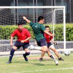 Student kicks football for goal