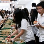Students eat pizza for Math day
