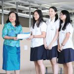 Students receive certificate from director