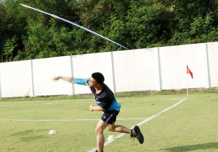 Student throwing javelin