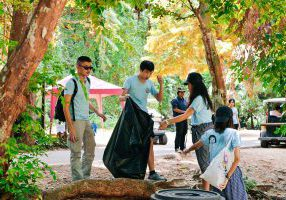 Students cleaning up trash